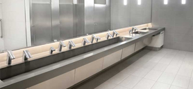 Touch-free restrooms sensor-operated products