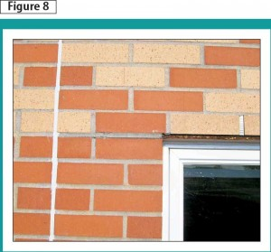 The shelf angle should not touch the mortar or brick below the angle.