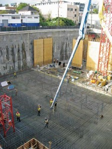 This photo shows the pouring of a concrete slab treated with a PRAH at a BC Hydro substation in Vancouver. Waterproofing was absolutely essential, as the project sits well below the water table and houses critical electrical equipment.