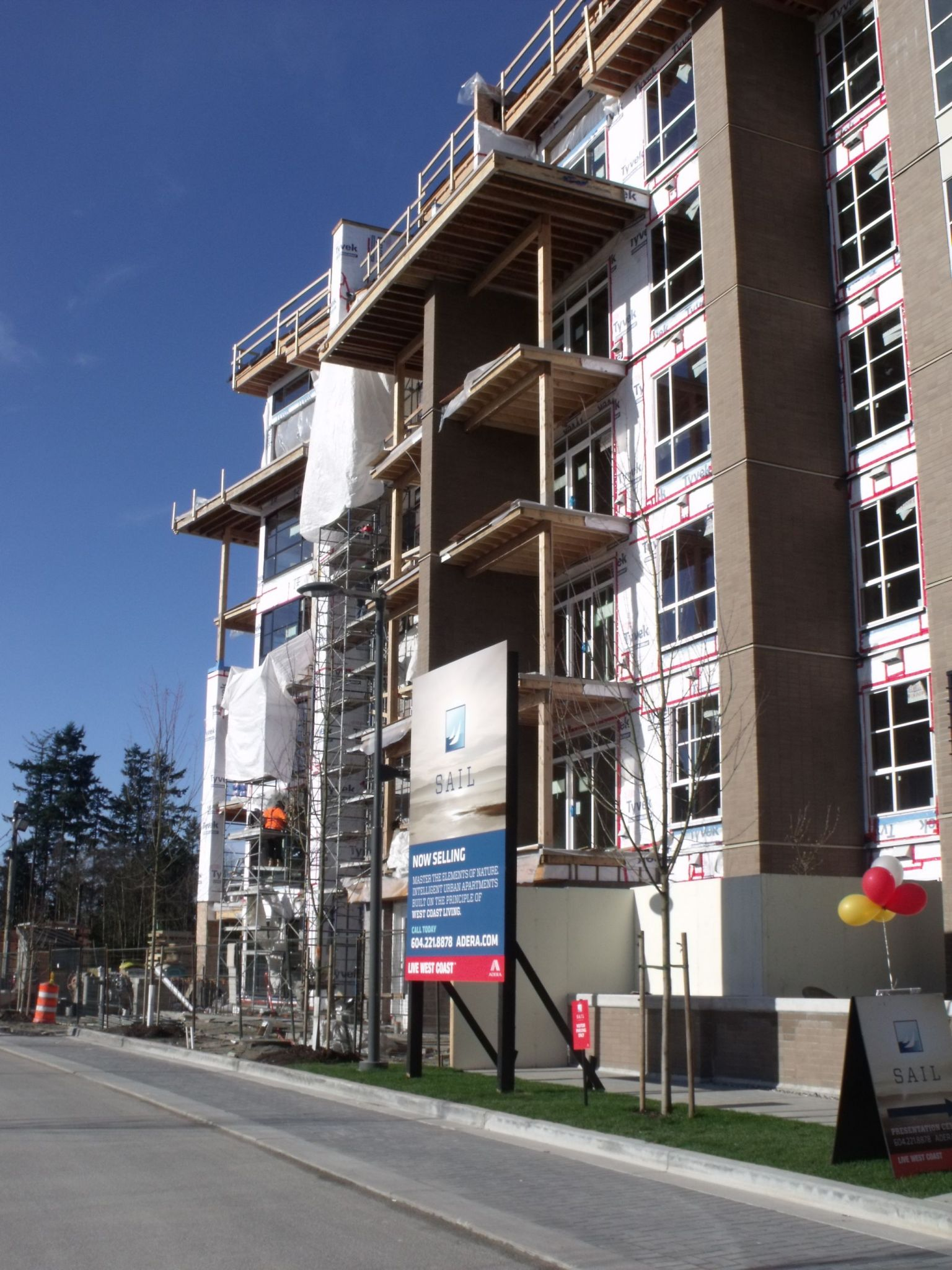 This photo shows the exterior of a six-storey condominium building under construction on University of British Columbia (UBC) Campus in Vancouver.