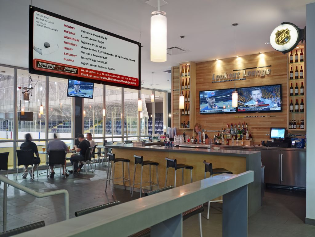 The interior of the Lookout Lounge restaurant features wood wall fi nishes at the bar.