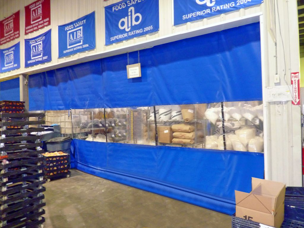Fabric curtain walls improve both indoor air quality (IAQ) and worker productivity by blocking out potential health hazards like dust and fumes.