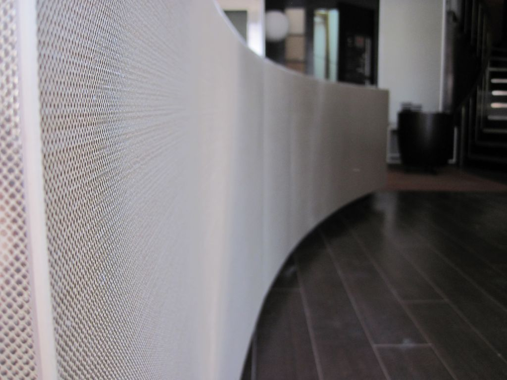 An interior curved wall featuring direct-bonded porcelain panels.