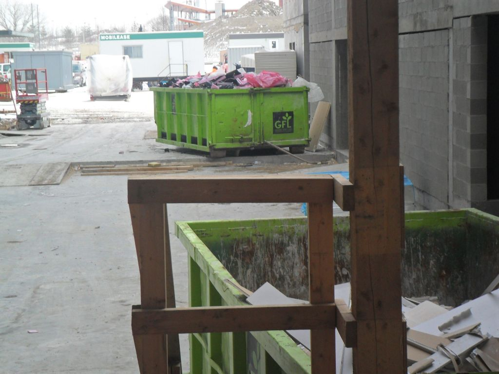 Convenient access to bins is provided by having two near each building hoist.