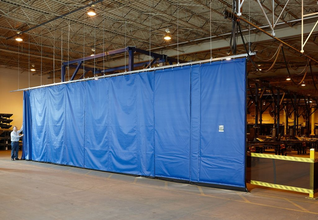 Flexible fabric curtain walls are specifi ed for industrial projects and plant operations because they can help manage physical space, while also safeguarding again environmental conditions like wind or sound.