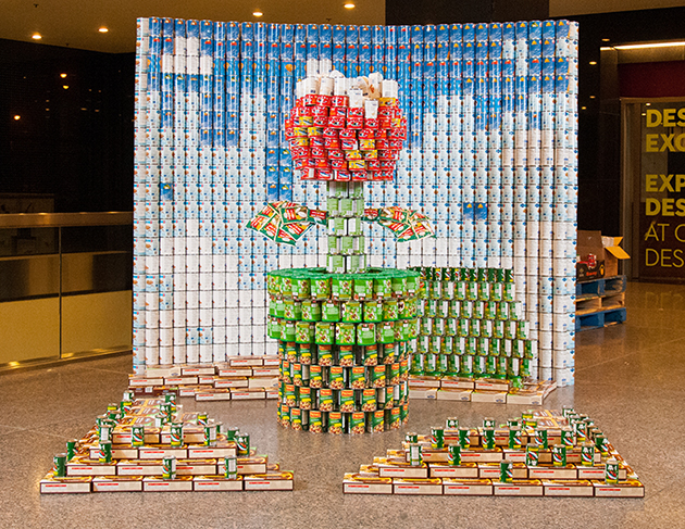 """Aecom Canada's entry in the 15th annual Canstruction Competition, """"Hunger, Just Like the Enemy, is Not Welcome Here,"""" earned the Best Meal award in this year's competition. Photos courtesy Canstruction Toronto"""