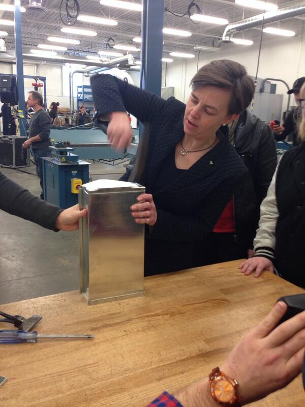 Minister Leitch tries her hand at a sheet metal work project following the CAWIC press conference.