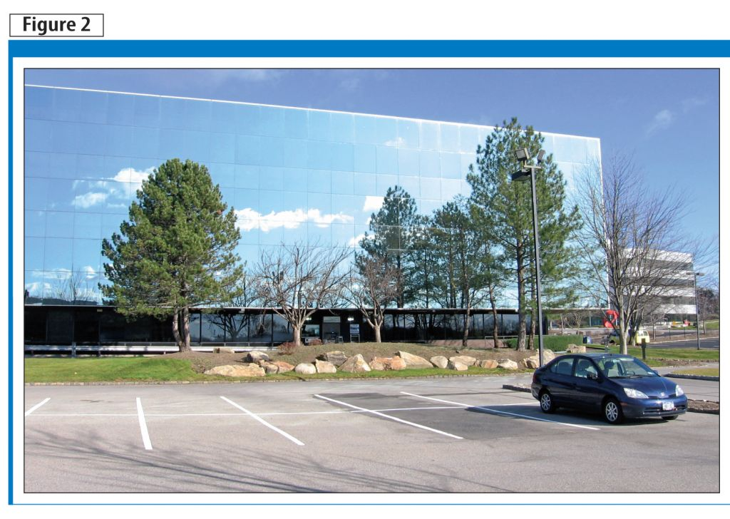 The deadly mirage presented through glass reflectivity is shown here, with a mirrored wall reflecting trees.