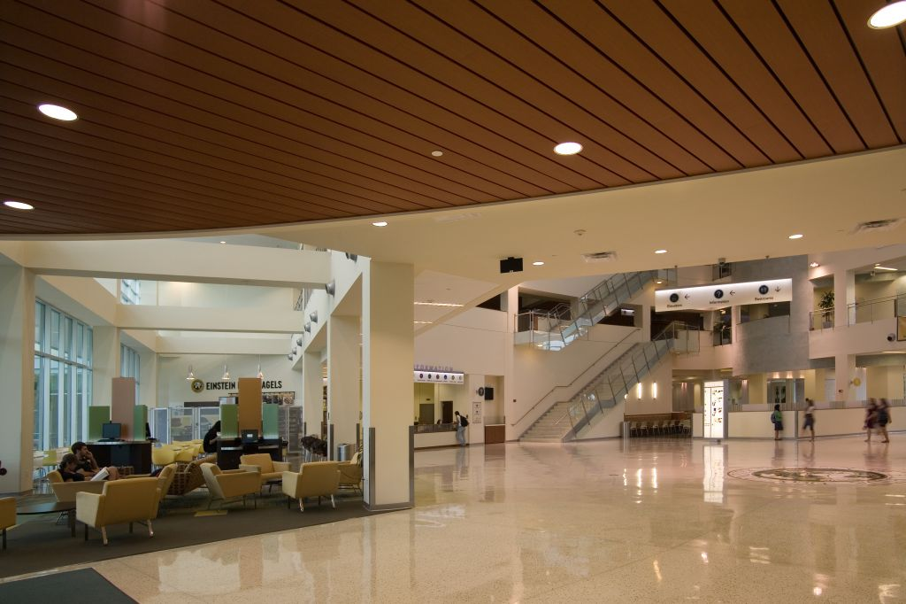 In high-traffi c areas such as lobbies, metal ceiling panels can help dampen the noise. This ceiling was specifi ed to meet both interior and exterior performance criteria, creating uniform appearance between the indoor ceilings and outside soffi ts. These systems may be installed as a fl at ceilings or curved to form vaults and valleys. Photo courtesy Chicago Metallic Corp.