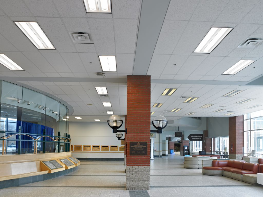 Grant MacEwan University replaced its old luminaires with lighting fixtures better suited for the school to reduce energy consumption, enhance lighting quality, and remain within the university's budget to replace 6500 luminaires throughout the campus.