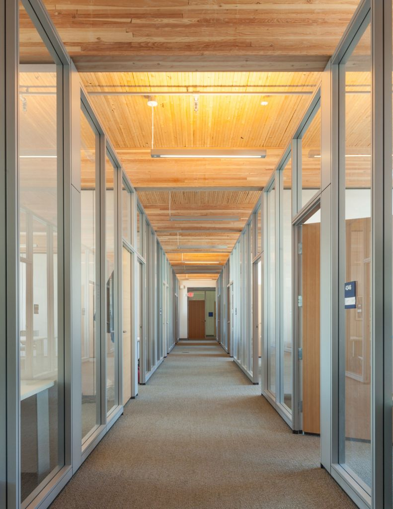A hallway in the CIRS building that uses displacement ventilation through a 457-mm (18-in.)-high ventilation plenum to distribute air strategically through floor diffusers. Photos courtesy Stantec
