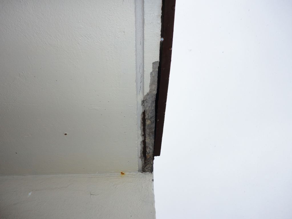This photo shows the drip slot running parallel to the slab edge. The steel placed too close to the drip slot has corroded, and the concrete has fallen off. If the steel had been placed higher in the slab or further towards the building wall, this failure would not have occurred. Building maintenance personnel should be alert to fine cracks in the drip slot as these are typically a warning that loose concrete is developing. For safety reasons it should be removed before it falls, potentially causing injury.