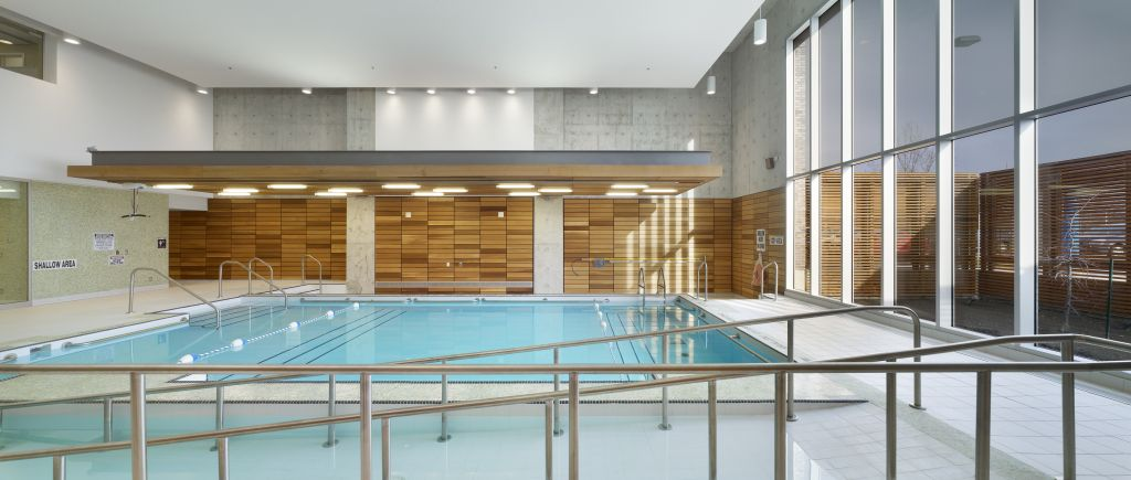 A hydrotherapy pool includes ceramic tile, wood, and an acoustic panel ceiling help create a calming, restorative atmosphere.
