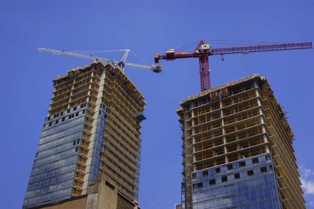 bigstock-Construction-Cranes-At-Twin-Hi-4510953