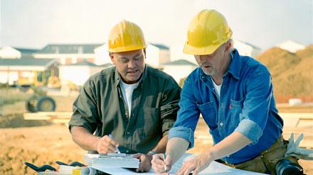 bigstock-Contractors-Talking-4542608
