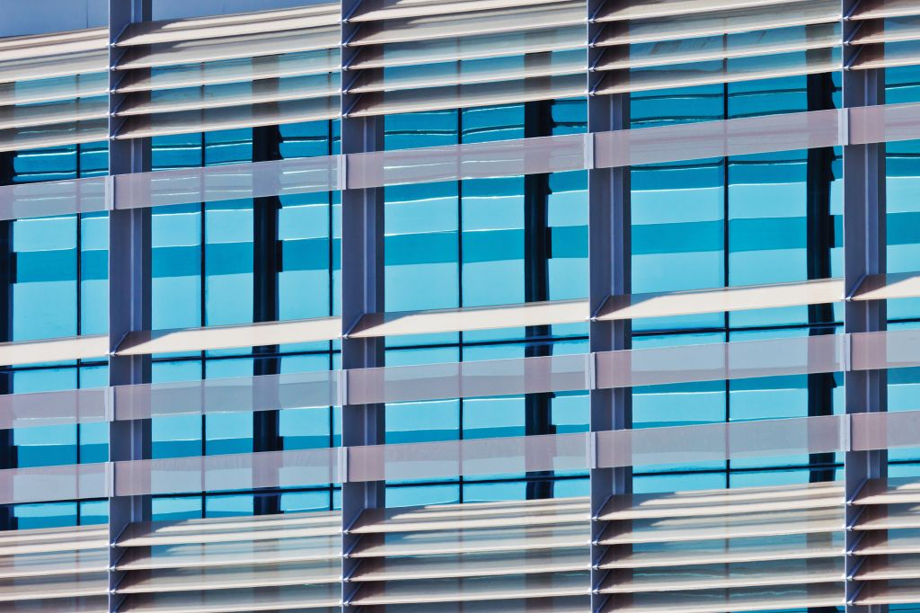 External automated shading can use intelligent control systems to automatically track the sun and position blade elements to block direct glare, while still allowing penetration of natural daylight. Photo © BigStockPhoto/Sascha Preußrer