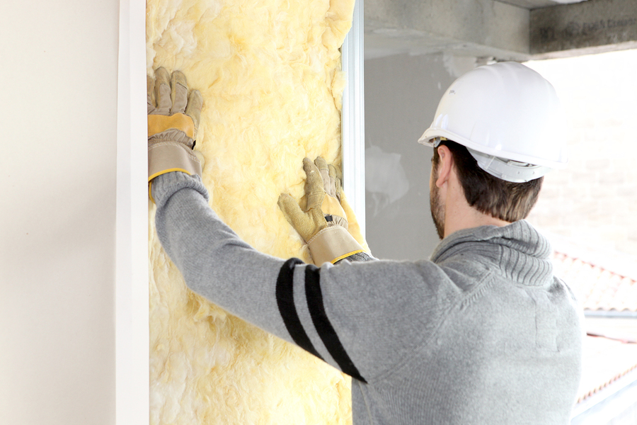 bigstock-Worker-laying-insulation-12641423(2)