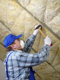 bigstock_Worker_thermally_insulating_a__26203589