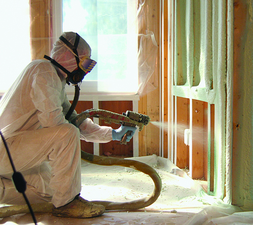 When applying closed-cell sprayed polyurethane foam (ccSPF), workers must wear appropriate personal protective equipment (PPE). Sprayfoam is commonly used as a wall insulation system (as shown) and also in attics, basements, and roofs.
