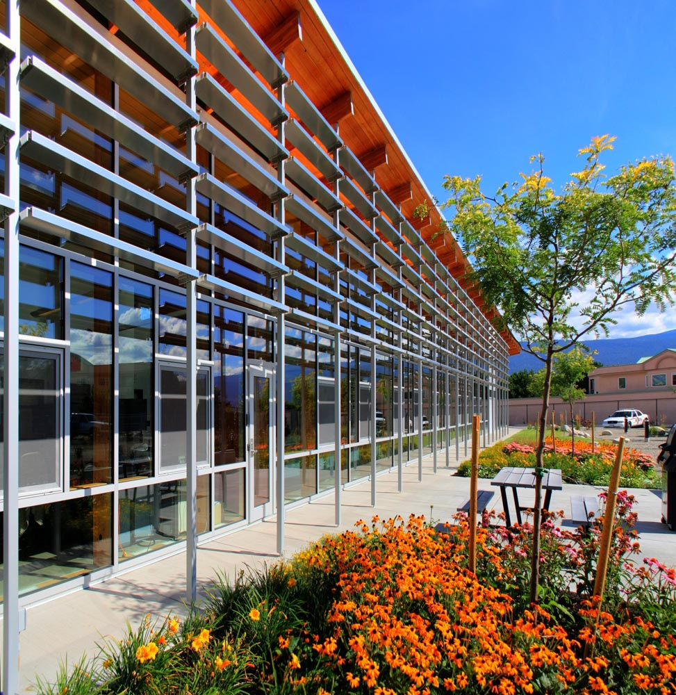 The south side of the Royal Canadian Mounted Police (RCMP) Summerland detachment building in B.C. contains fixed sun shades that allow daylighting while also shielding office space from solar glare. Photos © Allen+Maurer Architects
