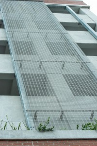 Designers used a total of 860 m2 (9257 sf) of metal mesh. The design called for strategically placing the material on the outside walls and inside the stairwells of the six-storey parking structure.