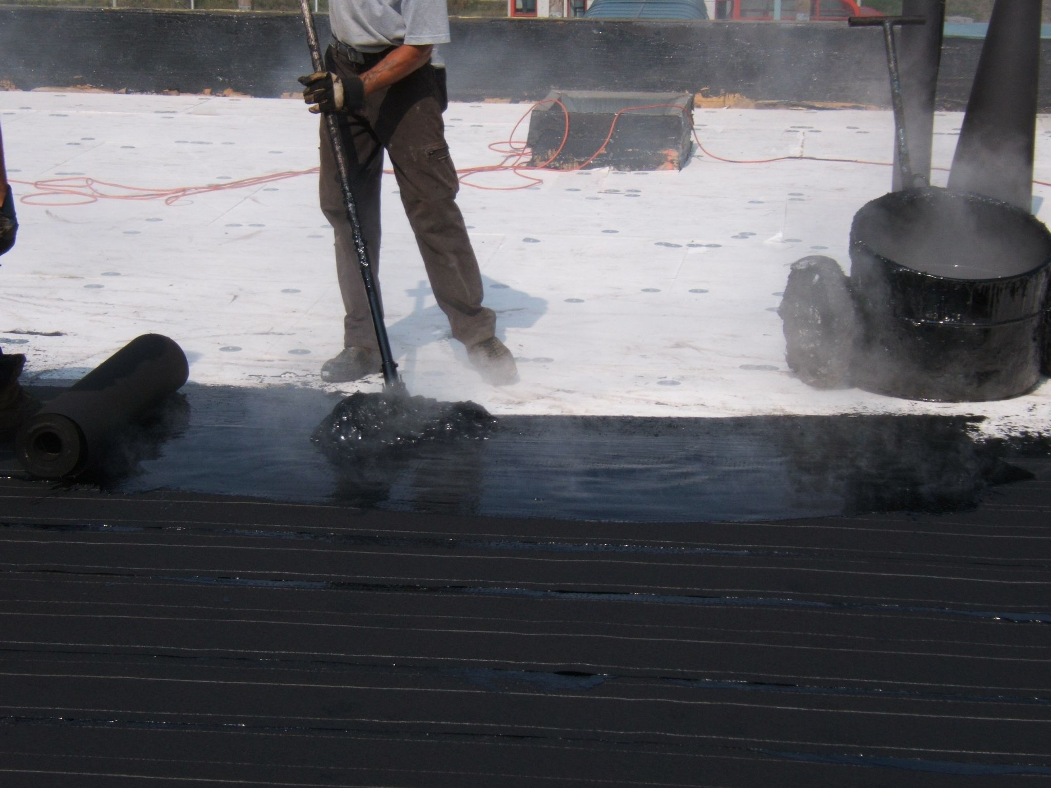In addition to standard grades of roofing asphalt, polymer modified asphalts such as styrene-ethylene-butylene-styrene (SEBS) can also be used to further enhance the membrane performance.
