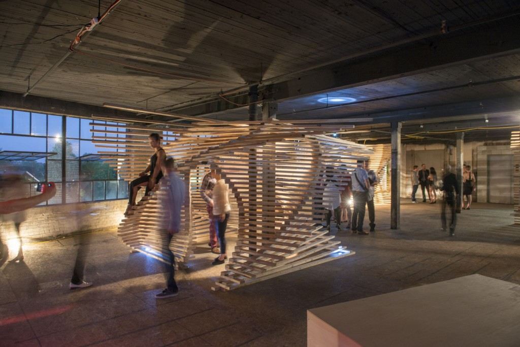 Interactive displays showcased the materials used through Toronto's skyline at the RAW MATERIAL event. In total, 550 2x4 studs were used to create three versions of this wooden structure.  Photo © Bob Gundu