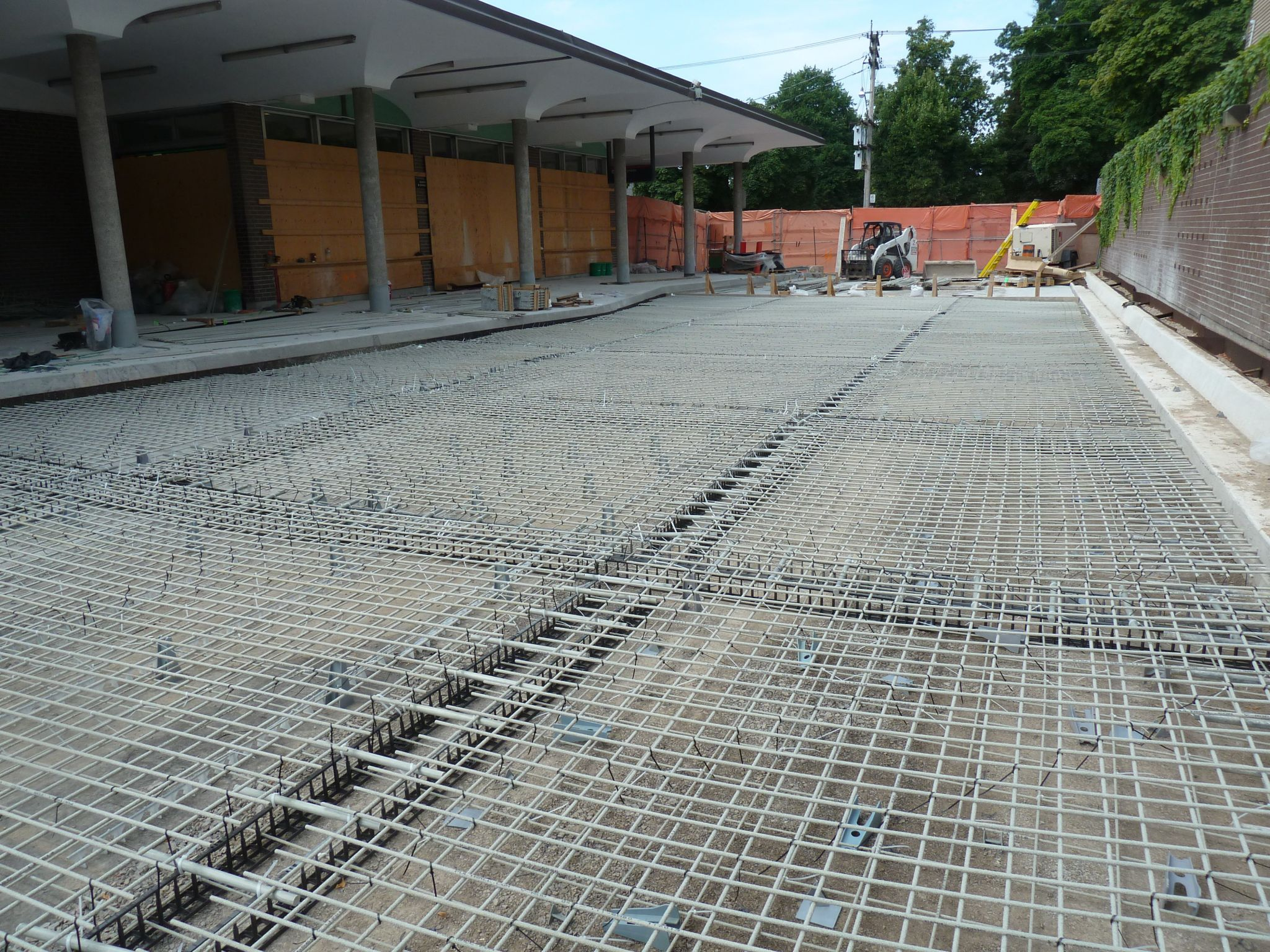 The bus driveway pavement used GFRP bars and dowels during installation.