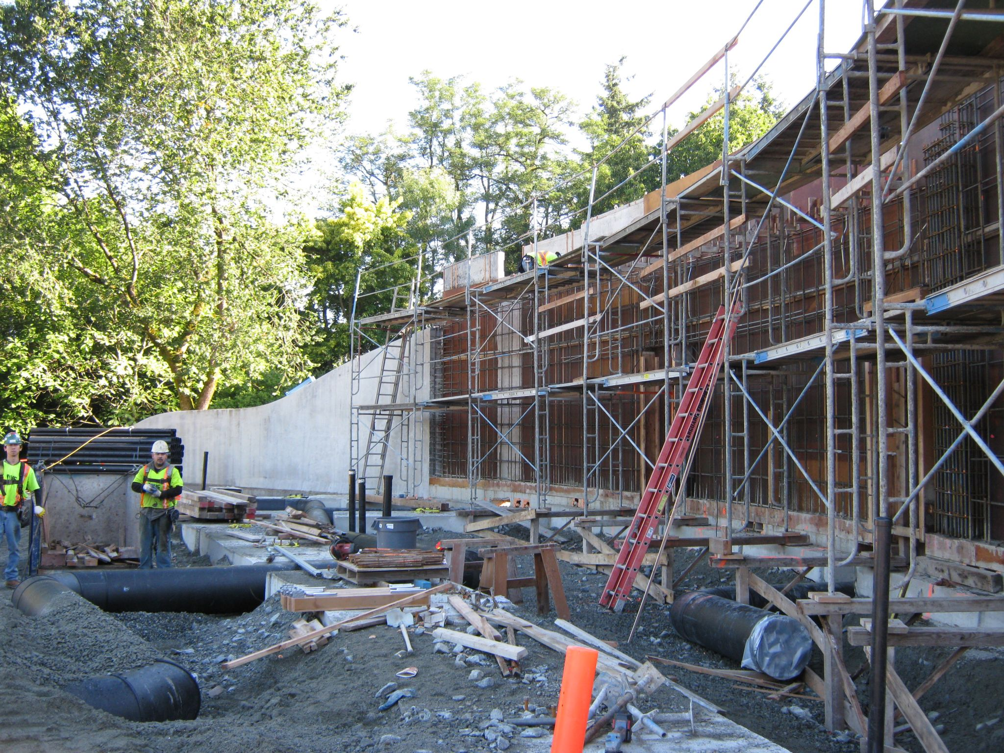 An exterior view of a feature wall being prepared for shooting.