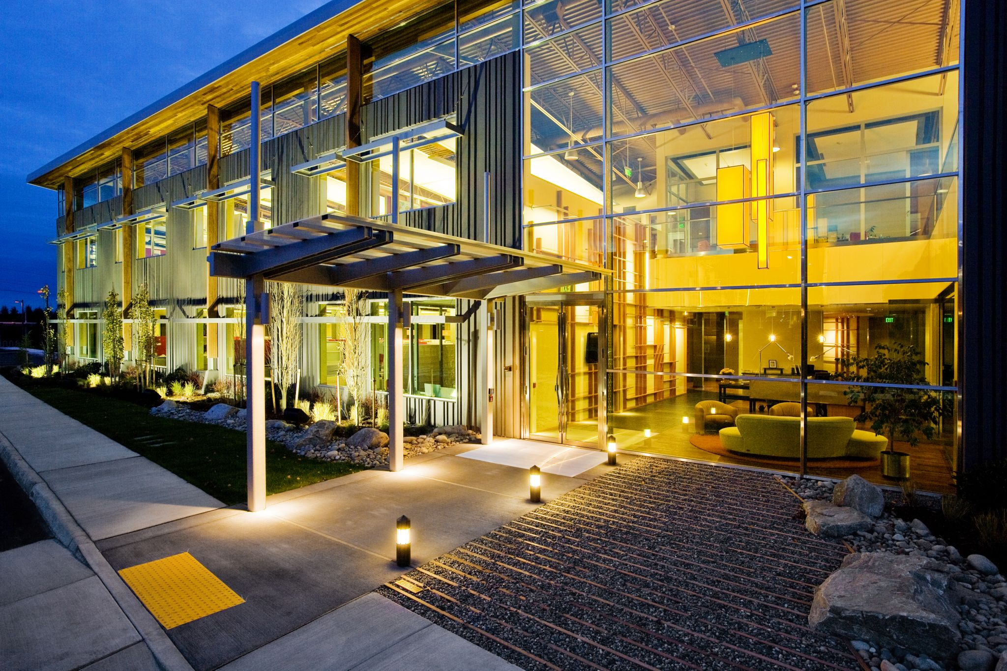 Steel curtain wall frames can support high-performance glazed units to balance natural light admission with energy costs.