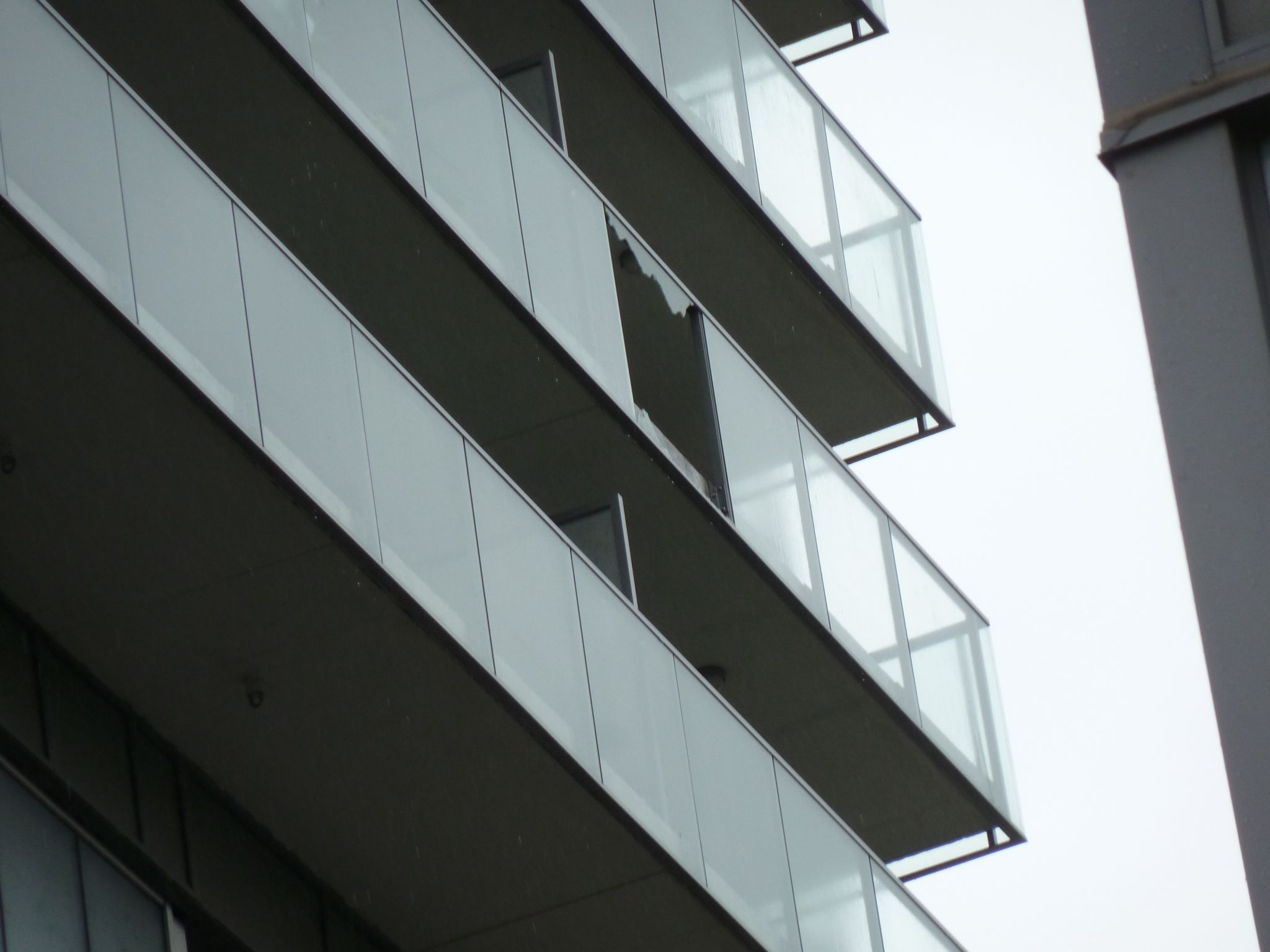 An example of spontaneous glass breakage on a balcony.