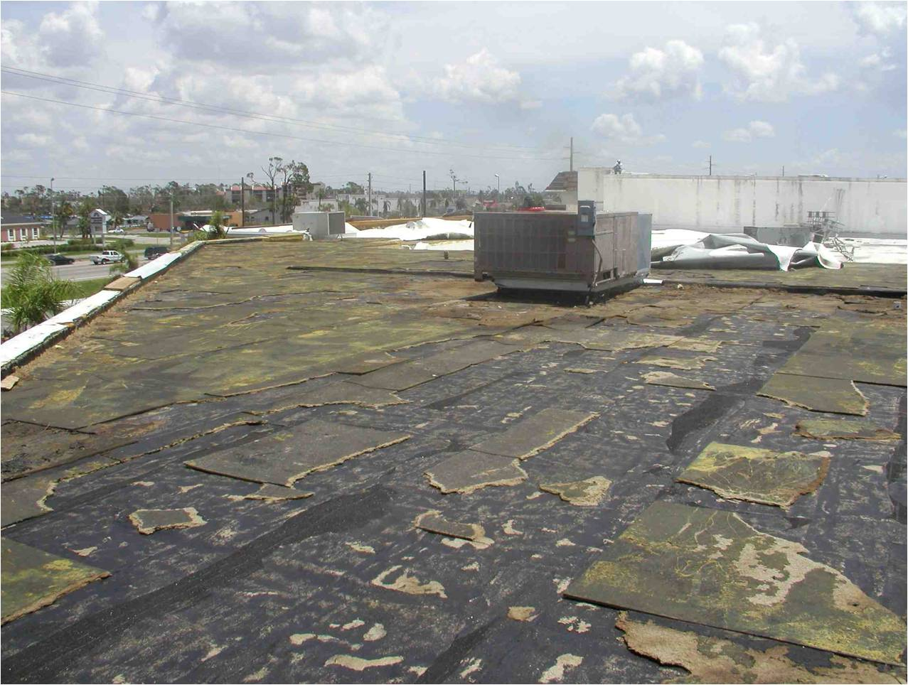 It is likely FM Approvals believes its changes to FM 4470 will reduce insurance risk and provide greater safety factors on its insured buildings. Despite the roof damage shown here after a Florida hurricane, the integrity of the roof deck has not been compromised. Photo courtesy SPRI