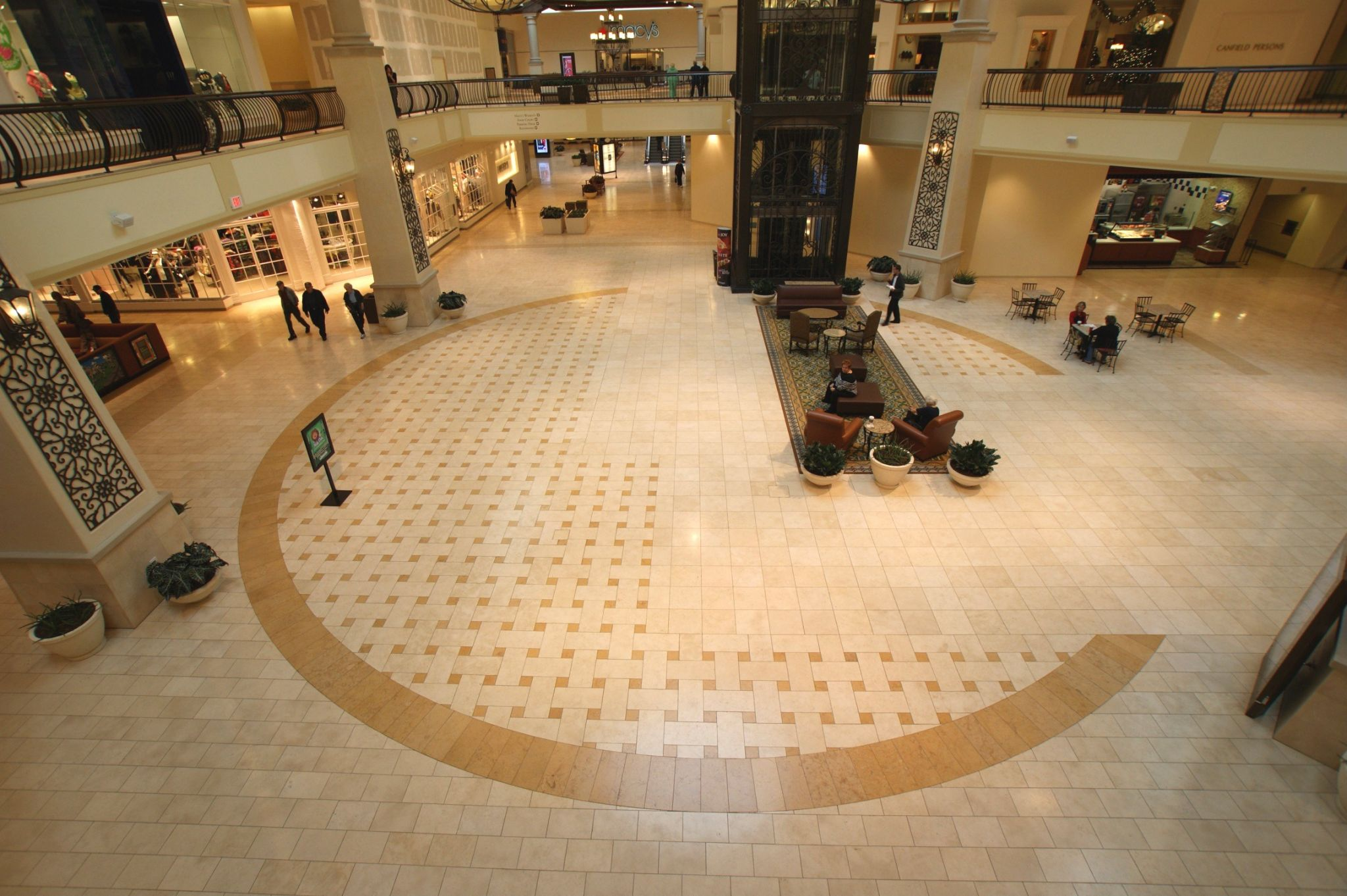 This creative pattern of different limestone tile colours and sizes was installed on fl oors at the Oaks Hill Mall in California by Premier Tile & Marble Company.