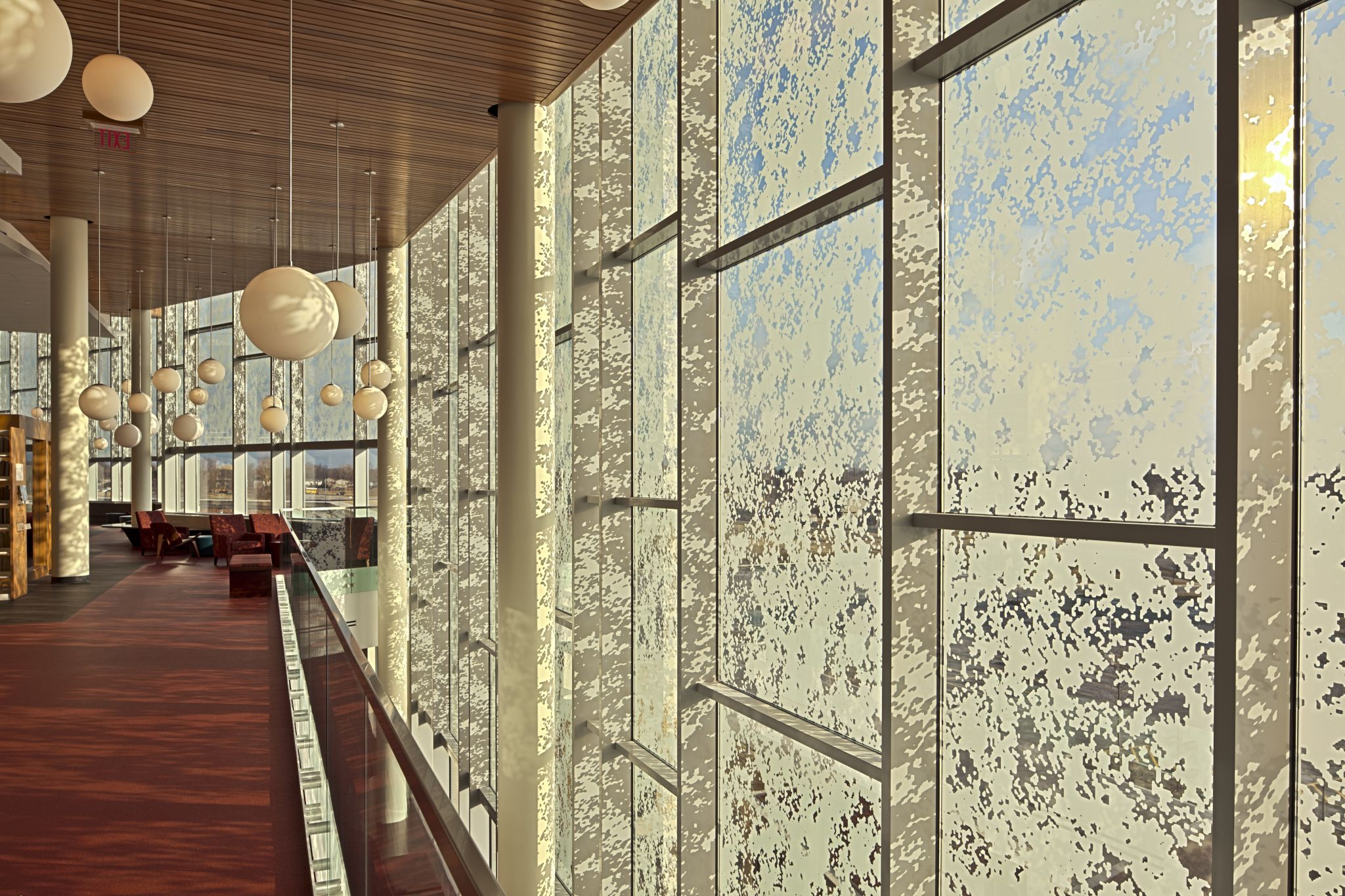 Silk-screening diffuses light into a public library in Bolingbrook, Illinois, preventing an over-lit interior.