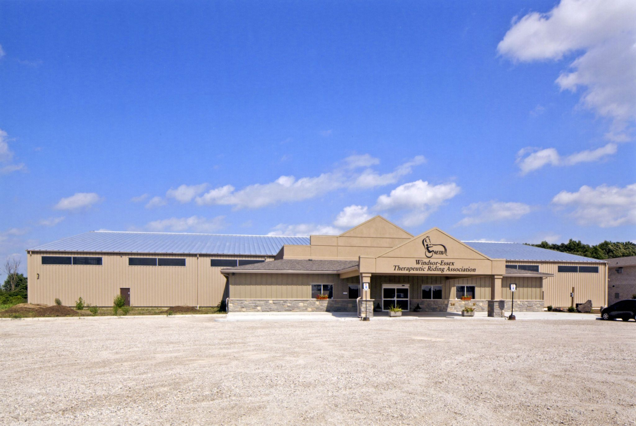 The Windsor-Essex Therapeutic Riding Association located in Essex, Ont., is a 21,367-m2 (230,000-sf) facility that provides equine-related therapy to those with disabilities.