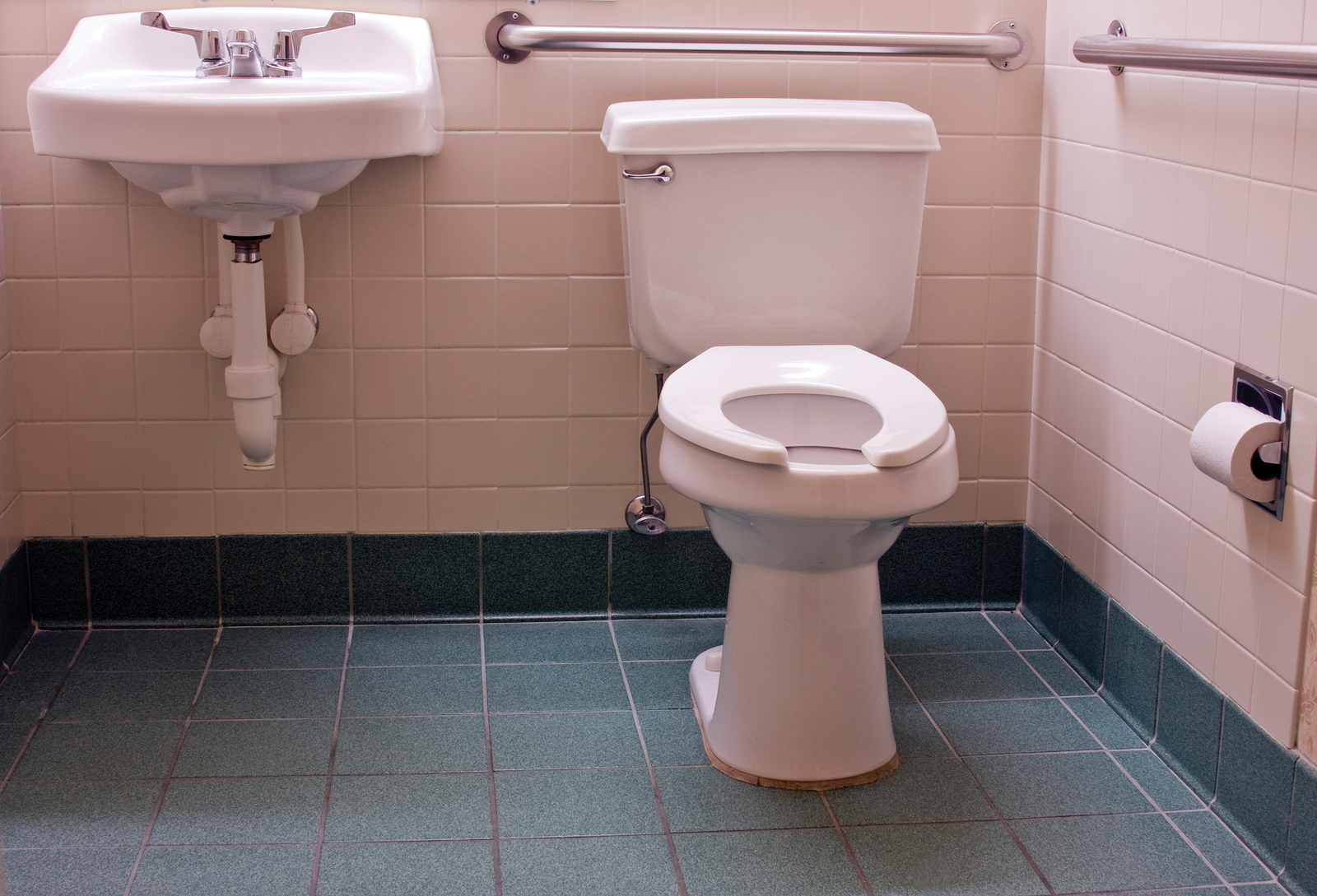 In the case of handicap-accessible toilet compartments, designers must remember some washroom accessories require a minimum clear fl oor area of 750 x 1200 mm (30 to 47 in.), and others must be accessible from a W/C. Photo © BigStock/Dave Willman