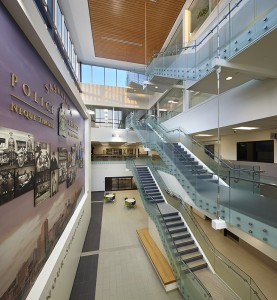 The 24/7 public entrance is through a large, open lobby leading to an atrium with a suspended staircase, awash with natural light thanks to floor-to-ceiling windows. The building's central atrium and staircase connects all four floors.