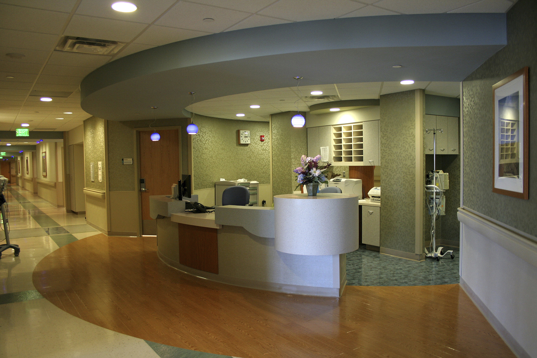 Some hospitals have moved away from using traditional centralized nursing stations in order to prevent large groups of people from talking near patient rooms, potentially disturbing those recovering from procedures. Photo © iStockphoto.com/Domars