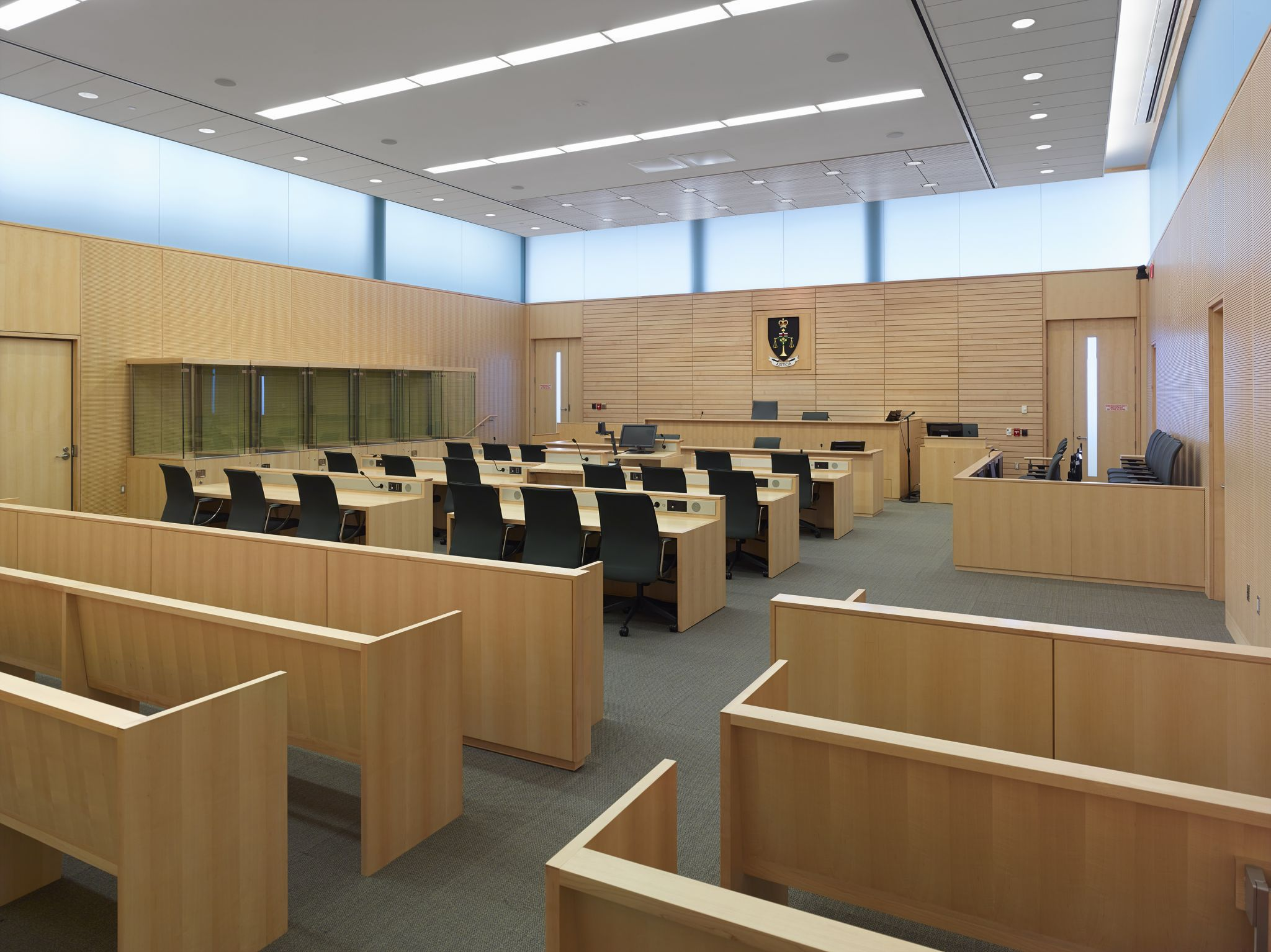 This is the interior view of the Multiple Accused High Security (MAHS) courtroom. The acoustical design, developed by Aercoustics and the project team, ensures acoustic audibility without the need for audio/visual enhancement.