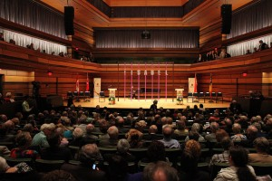 The performance hall features seating for 560 as well as retractable, motorized acoustic drapes offering sound absorption and improved reverberation time during concerts or other performances. Photo courtesy Queen's University