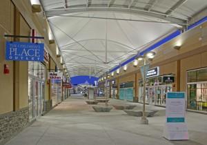 Polytetrafluoroethylene (PTFE) fibreglass membrane walkway canopies protect shoppers from any type of weather.