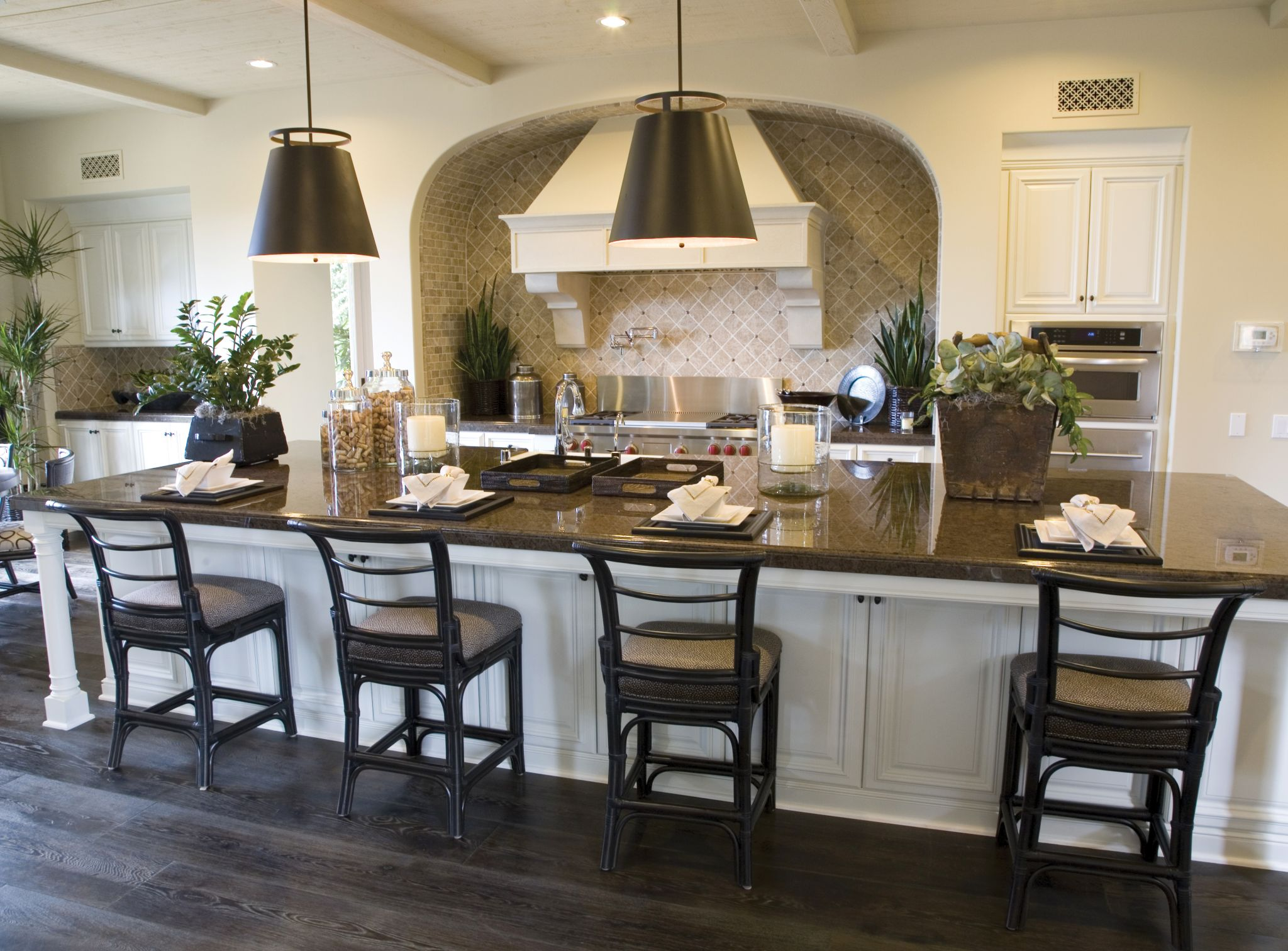 The size and weight of a large kitchen island can create floor deflection and poor performance; in these areas, the size of the members under the dead load can be increased or spacing tightened up. Photo © BigStockPhoto/Chris Rodenberg