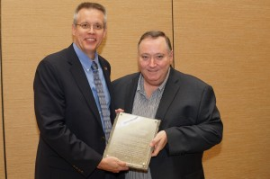American Concrete Pavement Association (ACPA) president Gerald F. Voigt, PE, presents the 2014 Sustainable Practices Recognition Award to Cement Association of Canada's (CAC's) president, Michael McSweeney. Photo courtesy ACPA