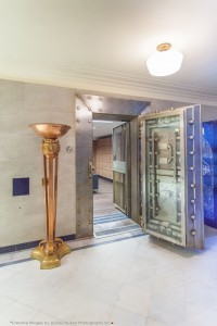 The original vault doors have been permanently pinned open and one of the vaults is used as a rental locker room.