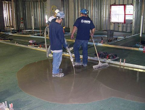 Application of Overlay on Prepared Floor Surfaces