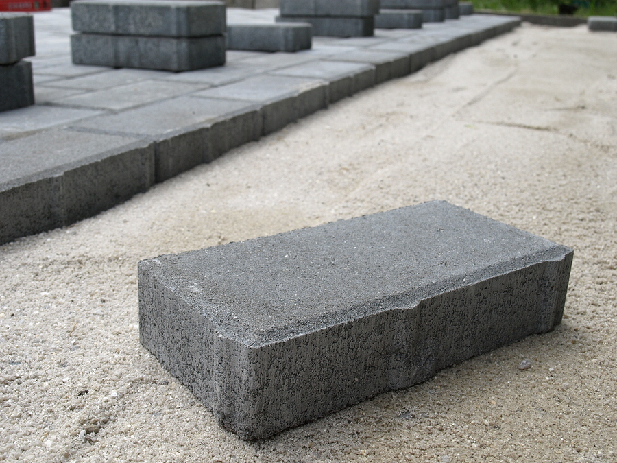 Stones blocks in sand prepared for pavement reconstruction
