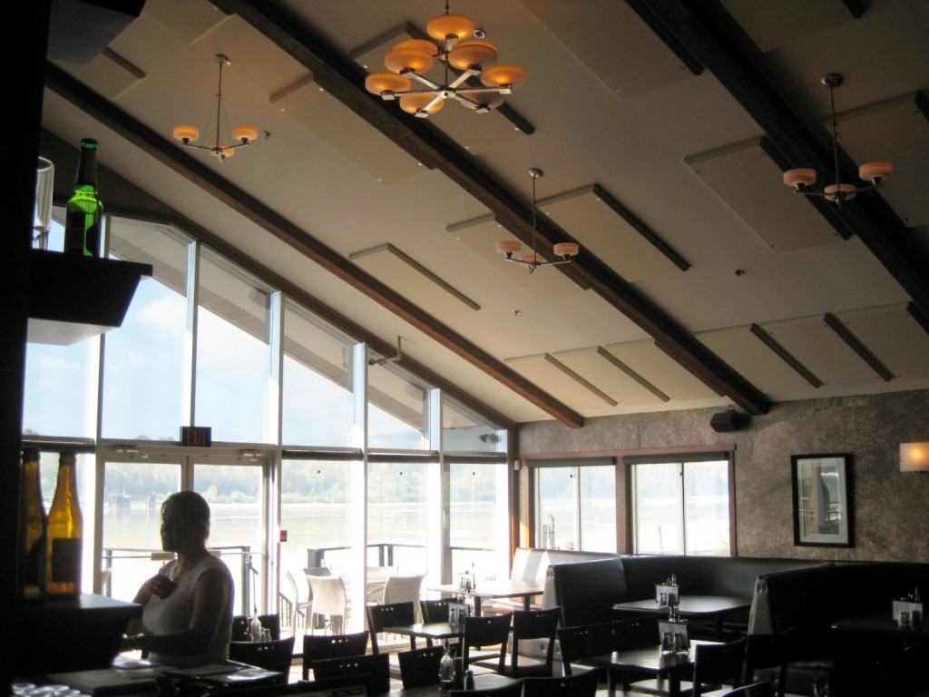 Kingfishers pub in Maple Ridge, B.C. provided a beautiful view for customers, but the glass wall and high vaulted ceiling contributed to long echeos and poor intelligibility. Broadway acoustic panels installed on the ceiling retained the esthetic, but fixed the sound issues. All photos courtesy Primacoustic