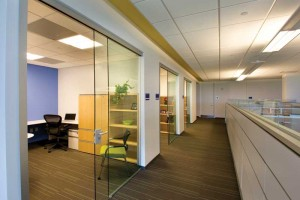 Sliding doors can help eliminate the feeling of being enclosed in a box. Minimizing materials and maximizing space are accomplished by concealing sliding panel hardware in overhead tracks that remove passage and view obstructions.