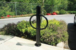 Bike parking bollards serve the dual function of directing traffic while providing cyclists with a secure storage option.