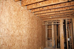 Load-bearing oriented strandboard (OSB) panelled shear walls support the engineered I-joist floor system and stand ready to assist the building in resisting any potential wind or seismic forces.